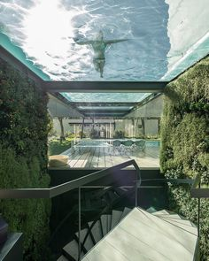 This is beyond amazingly stunning!!! Suspended glass bottomed swimming pool by Guedes Cruze Architects!! #homedesign #lifestyle #style #designporn #interiors #decorating #interiordesign #interiordecor #architecture #landscapedesign by adesignersmind