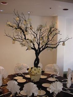 Manzanita centerpiece with blooms on branches and gerbera daisies