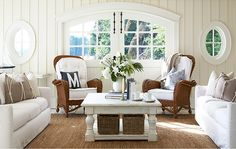 cottage living room with board and batten walls, wicker furniture and arched windows Living Room Styles, Living Room Photos, Living Room On A Budget, Home Living Room, Living Room Furniture, Living Room Designs, Home Furniture, Living Room Decor, Wicker Furniture