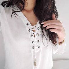 $11.18 Pretty white lace up blouse.