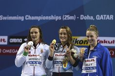 Katinka Hosszu of Hungary, Mireya Belmonte Garcia of Spain and Hannah Miley of Great Britain celebrates on the podium after the Women's 400m Individual Medley during day one of the 12th FINA World Swimming Championships