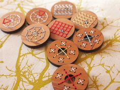 Love these new laser cut embroidered wood brooches from Kristen Doran Design.