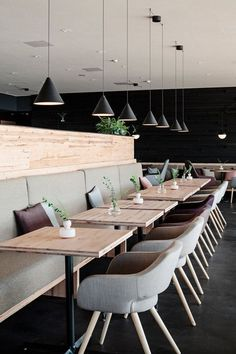 light wood partition and tables, light grey furniture and black for highlighting