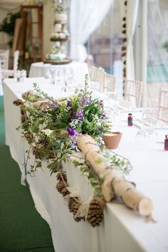 Top Table Flowers Log Green Purple Rustic Woodland Glade Wedding http://razzleberryphotography.co.uk/