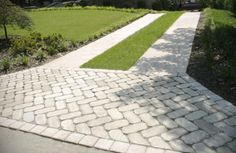 instead of concrete ribbon do cobblestone ribbons and and cobblestone by street Permeable Driveway, Stone Driveway, Driveway Design, Driveway Landscaping, Concrete Driveways, Outdoor Landscaping, Driveway Ideas, Walkways, Lawn And Landscape