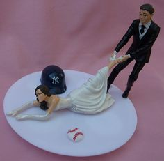 Cake topper. Etsy listing at https://www.etsy.com/listing/118818117/wedding-cake-topper-new-york-yankees-ny
