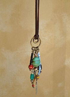 Sundance Pendant on Leather with Cascading Beads #handmade #jewelry #necklace: