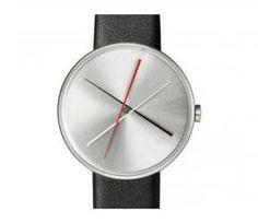 Relógio Steel Crossover   Moderno e Comteporâneo. Relógio Unisex, feito em aço inoxidavel e pulseira de couro. O ponteiro vermelho são os segundos, o branco é o ponteiro dos minutos e das horas é o preto.