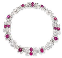 An art deco ruby and diamond necklace, circa 1935 The articulated necklace composed of a series of pierced geometric panels set with circular and oval cabochon rubies and brilliant, baguette and single-cut diamonds, to a concealed clasp