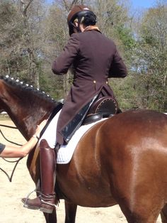Brown Custom Saddlery dressage saddle with brown shadbelly and Deniro boots!