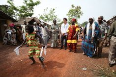Goodwill Ambassador Orlando Bloom is welcomed to Jene Wonde township in Liberia with a traditional ceremony involving multiple drummers, singers and dancers. 40 residents of the township died of Ebola between September and November 2014. Jene Wonde was declared Ebola-free last month. © UNICEF/NYHQ2015-0457/Jallanzo