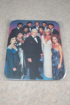 Mousepad with a Dynasty cast photo on Collectors Quest