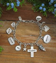 Family charm bracelet with name charms by www.nelleandlizzy.com
