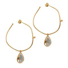 JAYLA EARRINGS - The Jayla Earrings are both timeless and trendy.  They feature a chunky tear shaped crystal that dangles from delicate freeform gold vermeil hoops. Wear these with a wrap dress and sleek hair for a sexy look thats irresistible. $38.00 www.michell.kitsylane.com