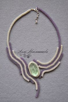 Bead-embroidered necklace by Alla Maslennikova with irregular cab and right angle weave sewn ropes