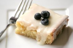 My friend makes this and it is amazing!!!  Almond Sheet Cake - (looks like a vanilla version of texas sheet cake)