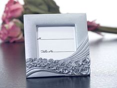 Classic silver poly resin placecard picture frames with roses design When your guests arrive to your wedding event they will be greeted with these