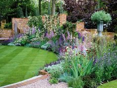 While the plants themselves seem a cottage garden jumble, this is actually a more formal garden design. The hard lines of the hardscaping and the repeating pants within the bed. Back Gardens, Outdoor Gardens, Amazing Gardens, Beautiful Gardens, Gazebos, Garden Cottage, Garden Borders, Flower Borders, Garden Spaces