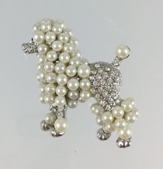 Vintage French Poodle Dog Brooch  Rhinestones by RhinestoneByrd...Looks like this poodle had some bubbles with his champagne, LOL!