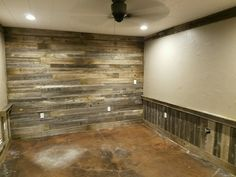 Remodel, repurposed old wood fence panels for a accent wall and chair railing