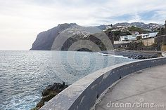 Coast line and view on cliff in  a small town Porto da Cruz by the shore of the Atlantic ocean. North side of Madeira Island , Portugal.