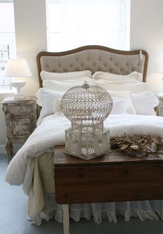 Pretty bedroom.  And I am loving the antique birdcage.