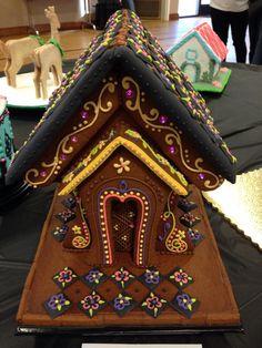 Gingerbread house in an unusually dark palette and flared shape. Lovely.
