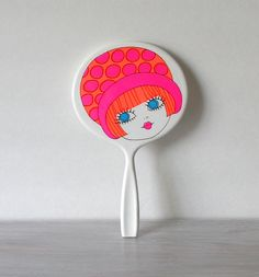 Circa 1960s Mod Hand Mirror Pink Orange. $12.00, via Etsy.