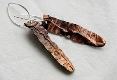 thin copper sheet was textured, heat oxidized, waxed, folded and flattened out, cut... sterling silver ear wires (bymitena, Etsy)