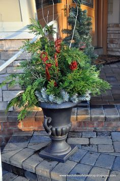 While I love the look of a home adorned with classic Christmas lights, my husband and I have never attempted to bedazzle our own home with outdoor lights for three reasons: I honestly have no Outdoor Christmas Planters, Christmas Urns, Christmas Lights Outside, Christmas Front Doors, Christmas House Lights, Outdoor Christmas Decorations, Winter Decorations, Christmas Ideas, Fall Planters