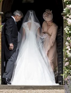 ENGLEFIELD GREEN, ENGLAND - MAY 20: Michael Middleton, Pippa Middleton and Catherine, Duchess of Cambridge attend the wedding of Pippa Middleton and James Matthews at St Mark's Church on May 20, 2017 in Englefield Green, England. (Photo by UK Press Pool/UK Press via Getty Images) via @AOL_Lifestyle Read more: https://www.aol.com/article/entertainment/2017/05/20/kate-middleton-serves-as-unofficial-bridesmaid-at-pippa-middleto/22100726/?a_dgi=aolshare_pinterest#fullscreen