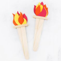 Looking for an easy Olympics craft for kids? This simple Olympic Torch Craft, created from construction paper and wooden craft sticks, is perfect for home or school.