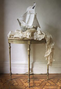 paper mache ship with waves