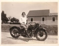 Girl on an old motorcycle: vintage
