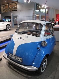 BMW Isetta. Small, fuel-efficient cars have been around for a lot longer than people think. My uncle had one of these  when he was in his early 20s.