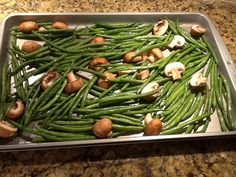 Fresh french-style green beans tossed with olive oil, salt and pepper with cremini mushrooms ready for the oven. Bake at 400 degrees for minutes. Yummy Vegetable Recipes, Great Recipes, Favorite Recipes, Tossed, French Style, Happy Holidays, Yummy Treats, Olive Oil, Green Beans