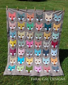 Fox quilt.  Keep the eyes, nose and cheeks along with the background consistent you can use all kinds of fabrics for the foxes.  Farm Gal Designs