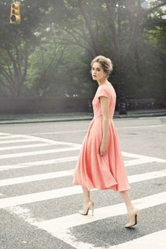 So classically chic: The up-do, nude heels, and a peachy-pink mid calf dress.
