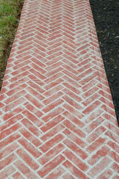 When you're SO over you're boring cement walkway, this might be the most inexpensive way to dramatically transform it!