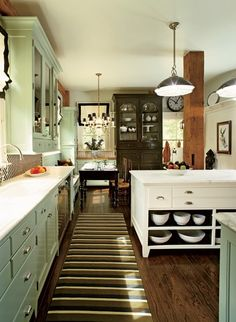 Love the seafoam color of cabinets and the white island; also the brown cabinet in the background