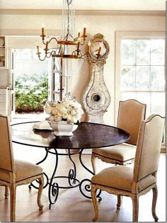 Dining room by Jane Moore. One or two key accessories, a gorgeous lighting fixture, and beautiful furnishings create understated elegance.