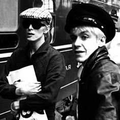 In an attempt to end his cocaine addiction, David Bowie leaves England and moves to West Berlin, where he begins collaborating with Iggy Pop and Brian Eno. Photo is of Bowie with Iggy at a train station in Berlin. The Velvet Underground, David Bowie, Grace Jones, Debbie Harry, Iggy Pop The Passenger, Mick Ronson, Im Falling In Love, The Stooges, Post Punk