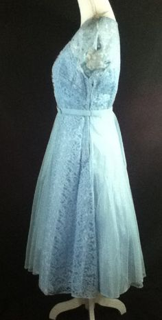 VTG Blue Handmade Bridal Formal Wedding Dress FABULOUS! No rips or stains found  Measured Size:Small  Details: Beautiful Neckline Handmade in the 50s or early 60s Side Metal Zipper Comes with belt DOES NOT come with crinoline   Bust: 34 (underarm to underarm) Waist: 26 with some stretch room Hips: free Length: 44 (shoulder to hem)  Please review and compare your measurements for accuracy.  This item comes from an estate filled with vintage clothing from the 50s-70s, with an emphasis on late…