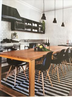 black and white accents with wood table as contrast and white walls