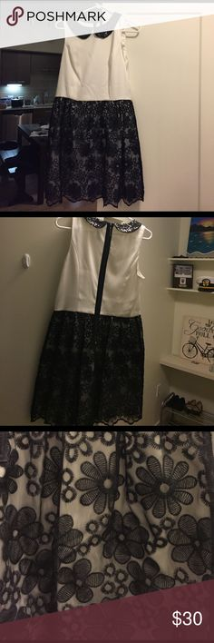 Black and White Schoolgirl Style Dress Black and white schoolgirl style dress. The skirt is a floral pattern, and the collar is sequin. Worn once. NOTE: Runs slightly big. I typically wear a size 6-8 dress and it was a little big on the waist. Kensie Dresses Midi