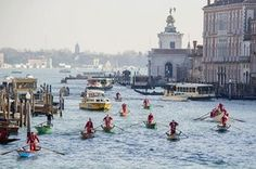 Rowers dressed as Santa take part in the seventh annual Father Christmas regatta organised by Ca' Foscari University on the Grand Canal in Venice. Champions and amateurs, men and women all wearing Santa suits compete in traditional Venetian boats. The race begins at San Marco (Pietà) and ends in front of Ca' Foscari. Photograph: Awakening/Getty Images