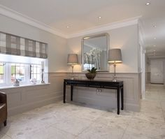 Dado walls in entry. Paneling painted in Elephants Breath with Skimming Stone above, paint available from Farrow & Ball. Flur Design, Hall Design, Painted Wood Walls, Wood Panel Walls, Wall Wood, Paneling Painted, Demis Murs, Wood Paneling Makeover, Contemporary Hallway