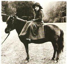 The Hon. Elizabeth Bowes Lyon as a young girl.