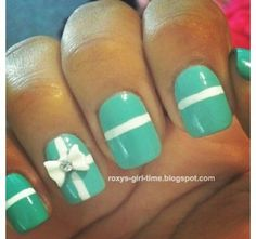Mint green nails with a bow and and white stripd use red for bow like Tiffany does