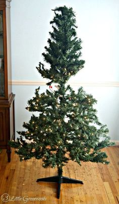trick for making a fake christmas tree look fabulous, christmas decorations, crafts, wreaths